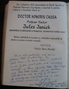 Jules Janick signing in Doctor Honoris Causa book