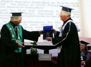 Rector Doru Pamfil giving DHC medal to Professor Jules Janick